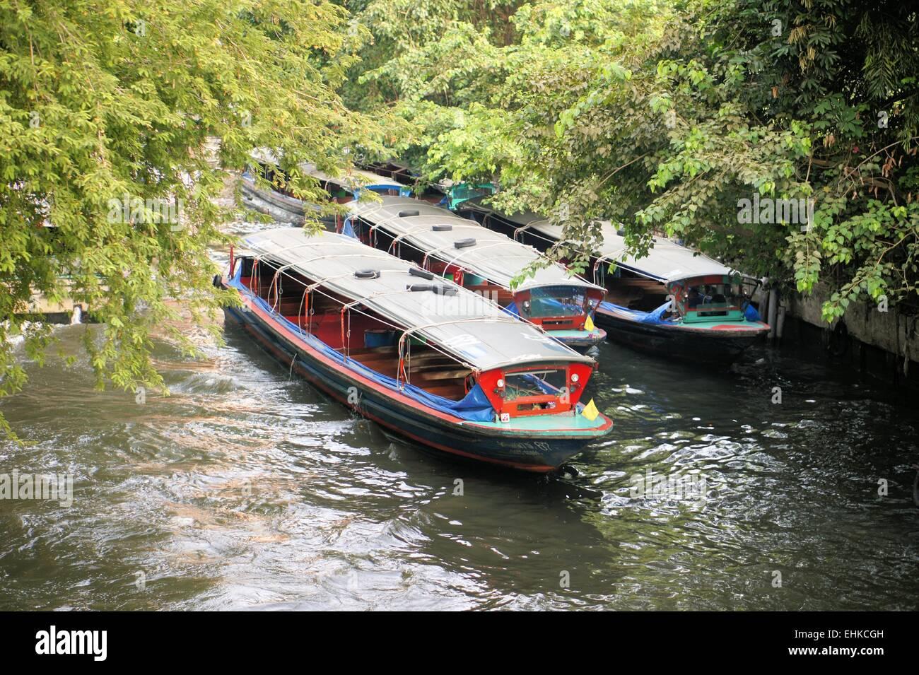 Boat speeding on San Saep canal in Bangkok, Thailand Stock Photo