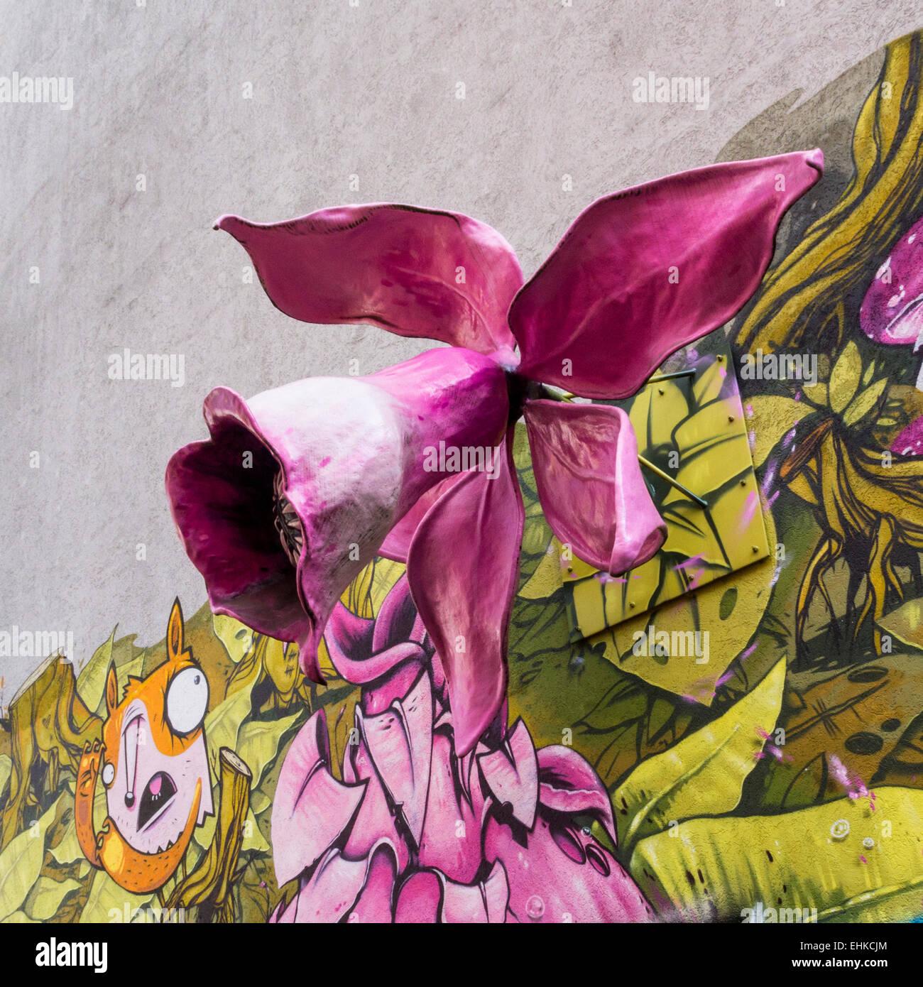 Berlin Street art and Graffiti, giant pink 3-D flower colourful floral urban mural art, Maybachufer, Berlin - Stock Image