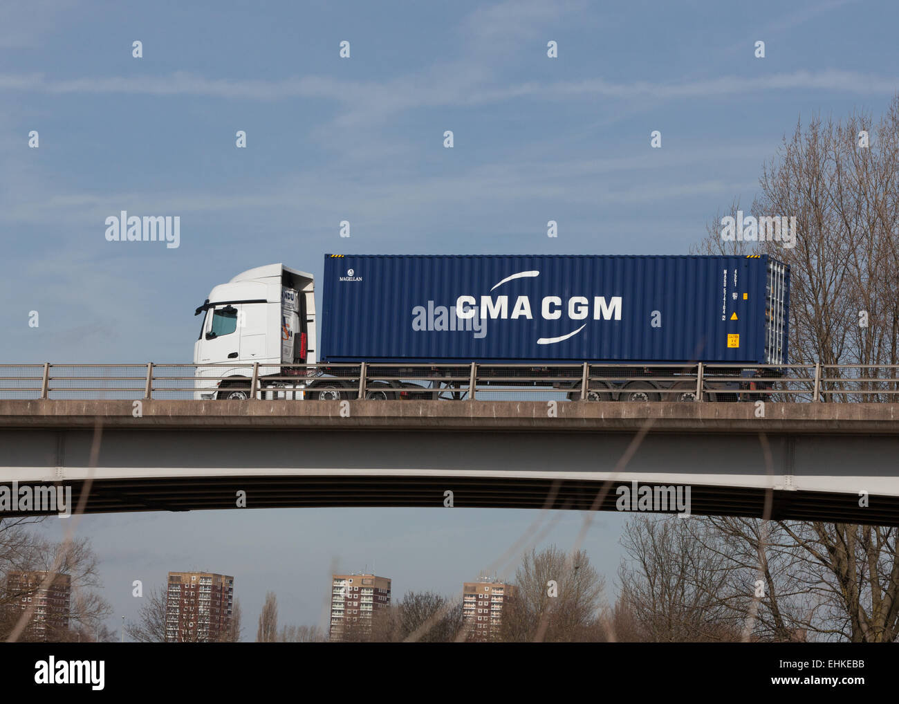 A CMA CGM freight container on a  truck travelling through the Midlands in the UK. - Stock Image