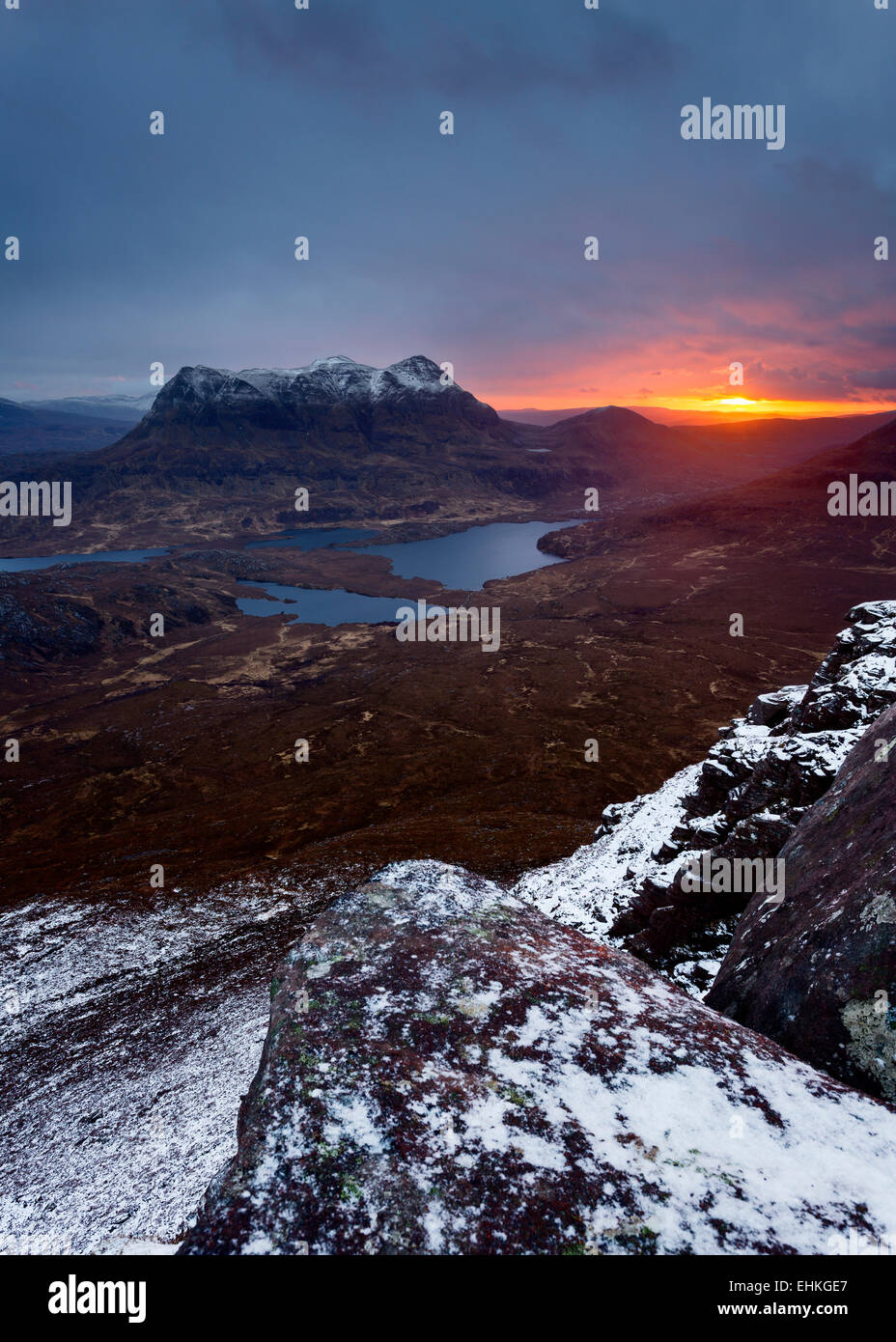 Sunrise behind Cul Mor seen from the summit of Stac Pollaidh - Stock Image
