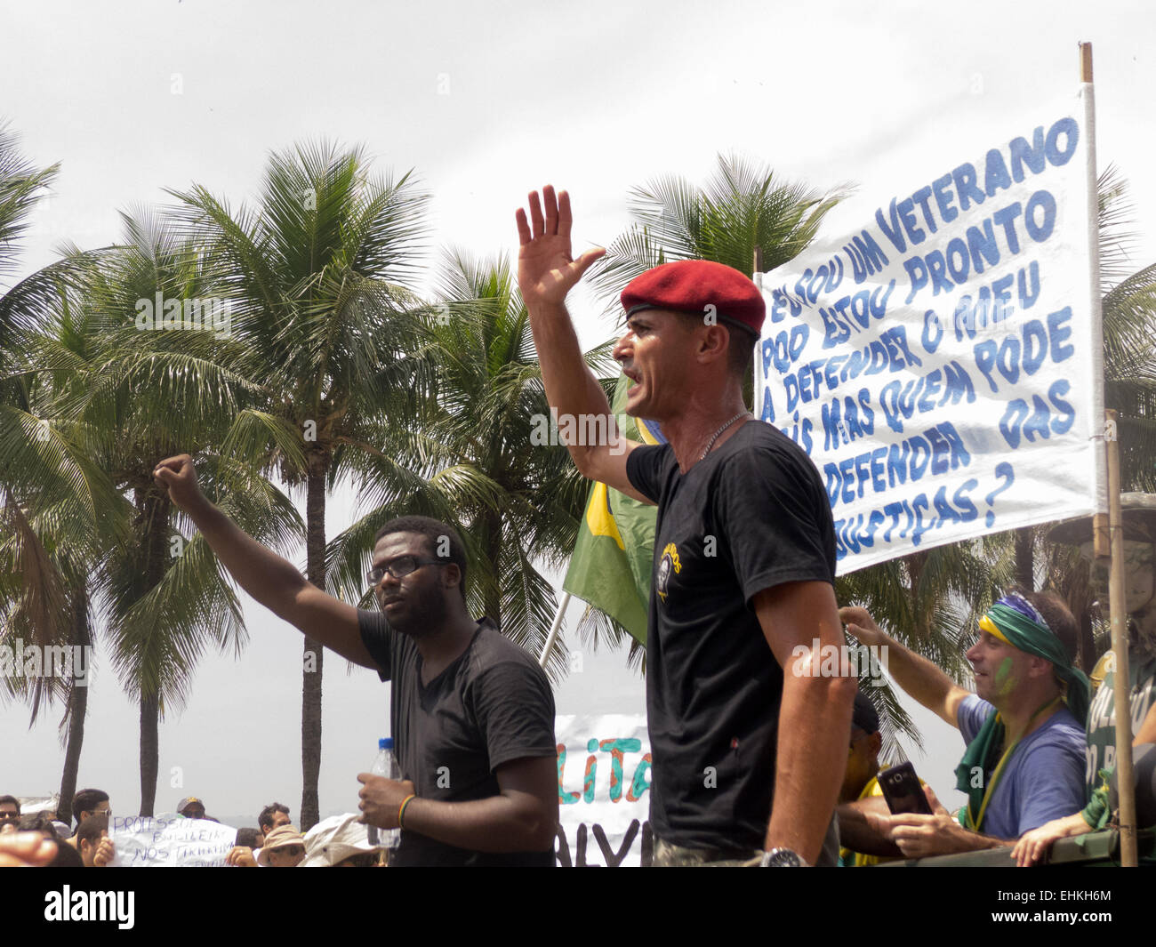 Military veteran chants in protest with an Afro-Brazilian beside him. Rio de Janeiro, Brazil. Demonstration against - Stock Image