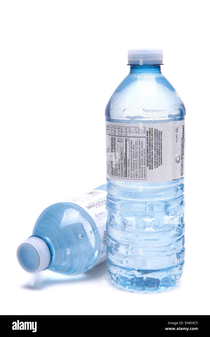 Bottled water close up shot isolated on the white background, shallow focus - Stock Image