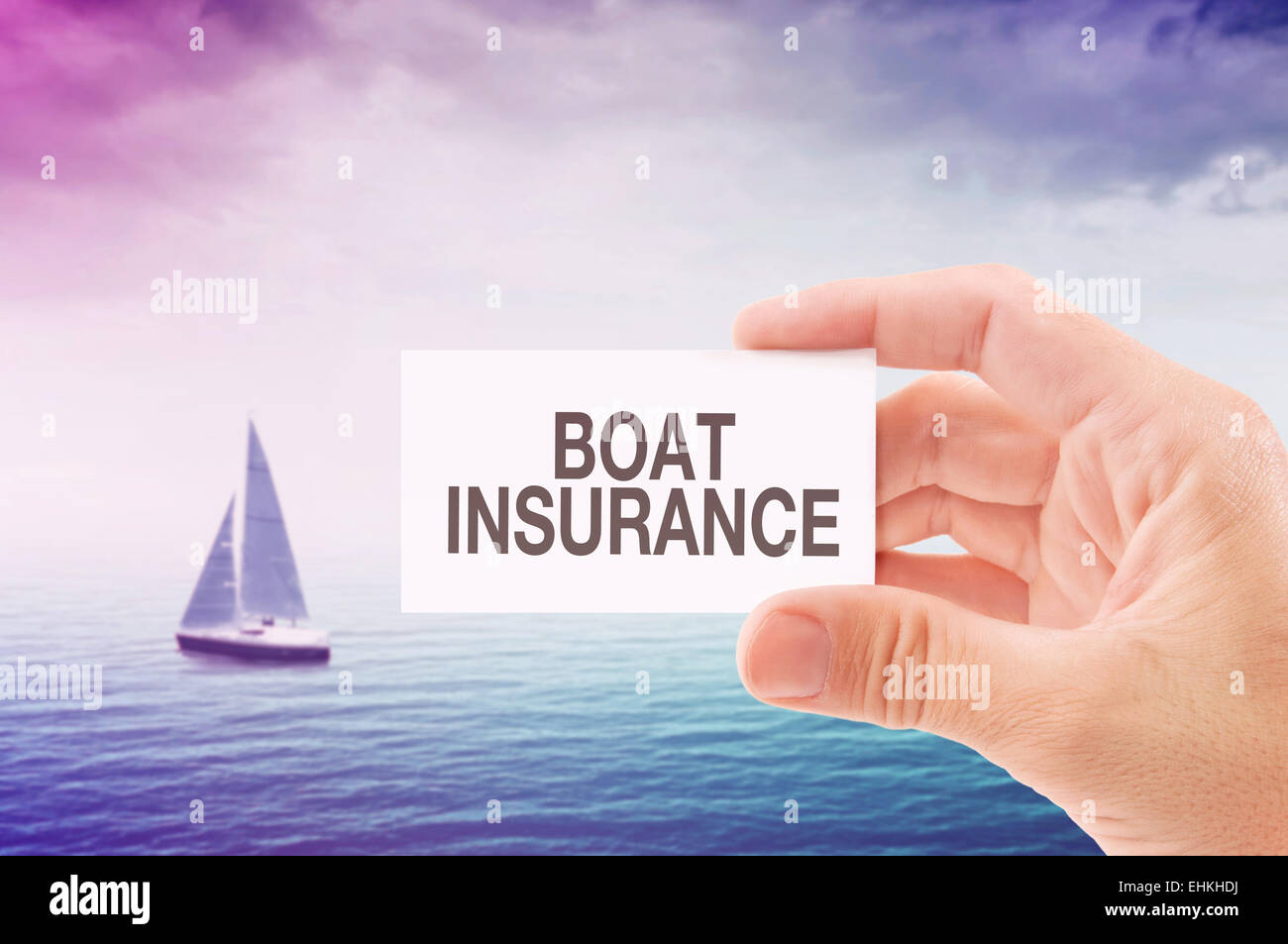 Boat Insurance Agent Holding Business Card, Sailing Boat on Open Sea in Background. - Stock Image