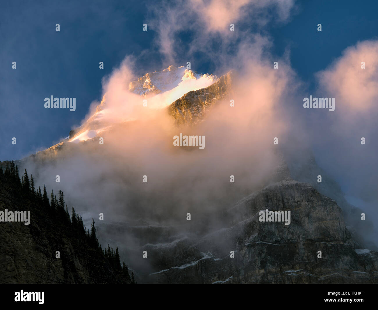 Early morning sunrise on peaks around Moraine Lake. Banff National Park. Alberta Canada. - Stock Image