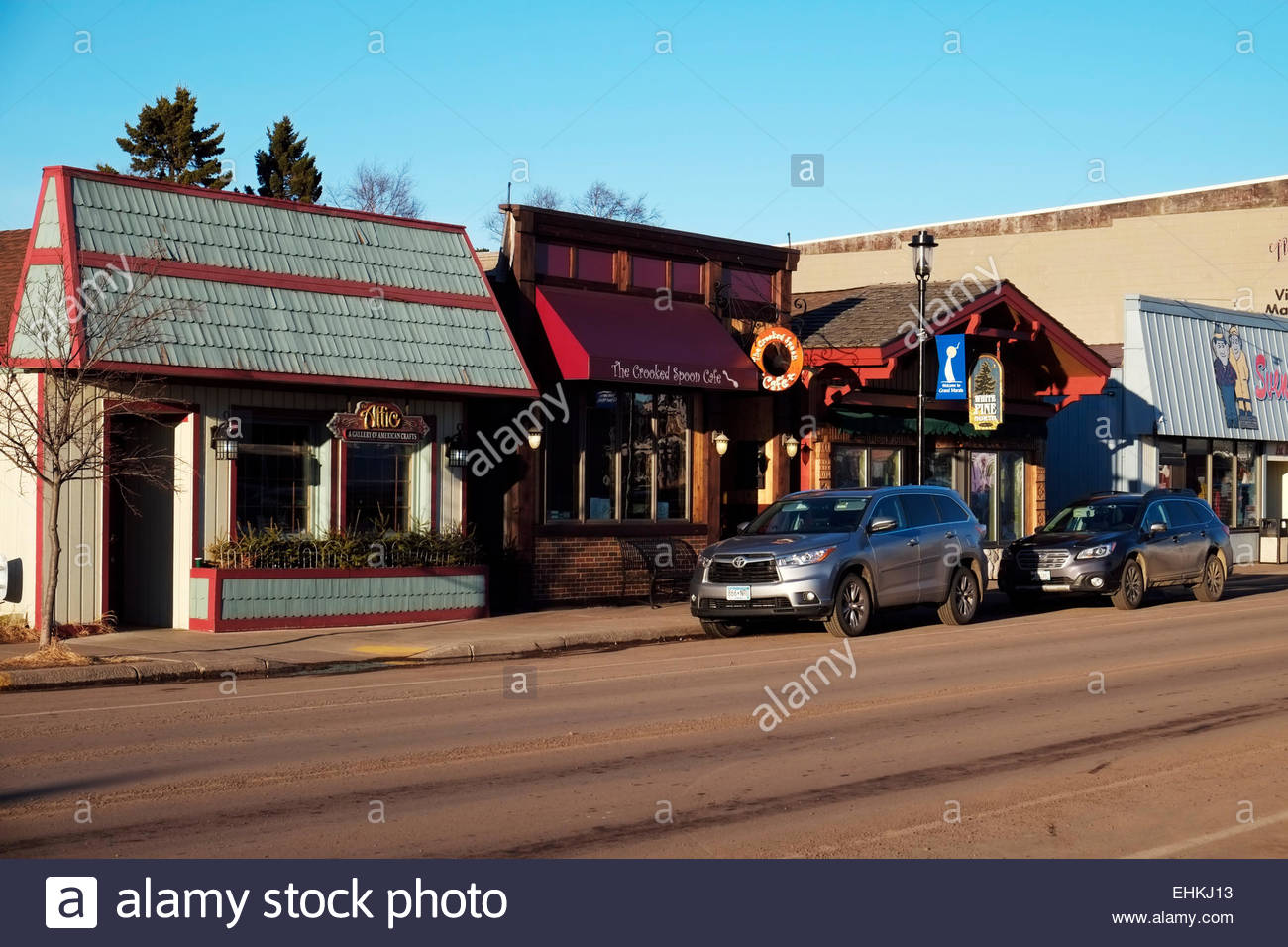 The Crooked Spoon Café, Attic arts and crafts gallery and other businesses in Grand Marais, Minnesota. - Stock Image