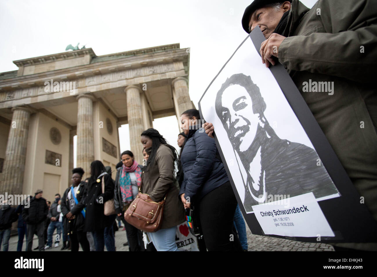 Berlin, Germany. 15th Mar, 2015. Demonstrators hold photos of people who were possibly killed through racist police - Stock Image