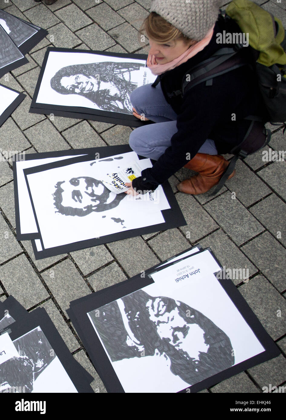 Berlin, Germany. 15th Mar, 2015. Photos of people who were possibly killed through racist police violence are shown - Stock Image