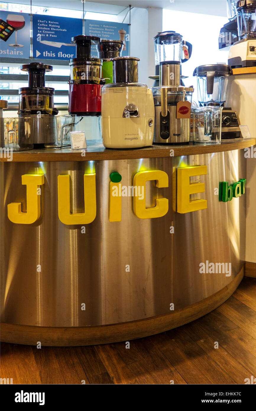 Juice machine on display in a kitchen store. - Stock Image