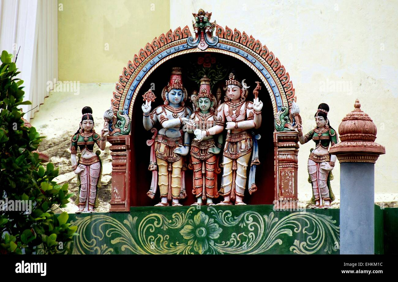 Georgetown, Malaysia:  A triptych of colourfully painted Indian deities at the Penang Nagarathar Sivan Hindu Temple - Stock Image