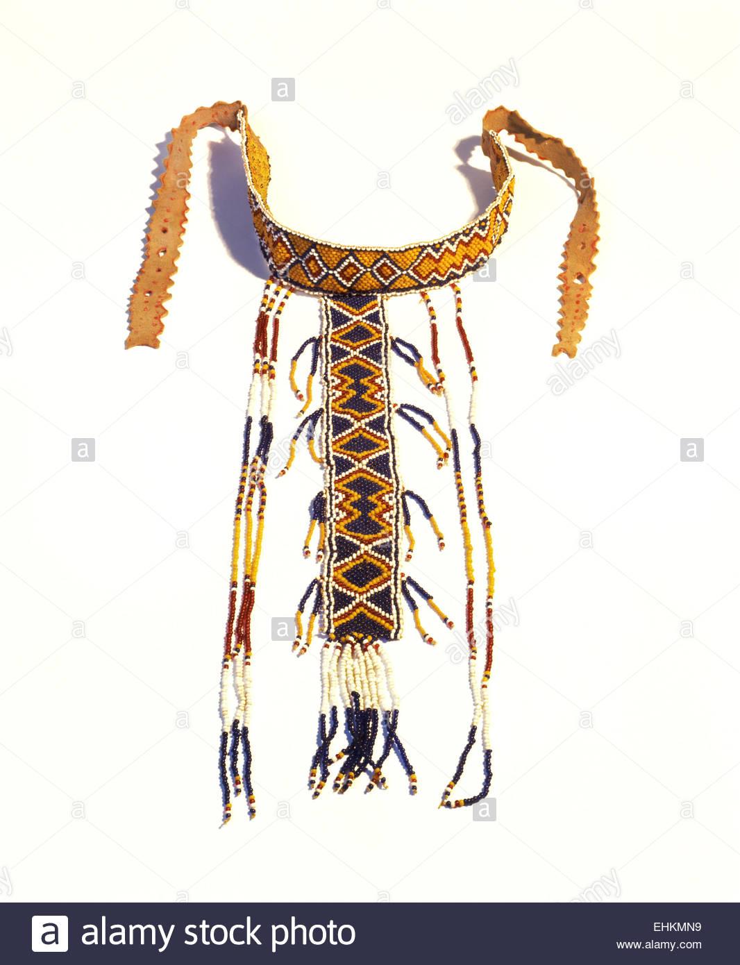 Western Apache girl's puberty ceremony T-shaped beaded necklace. Arizona, USA. - Stock Image