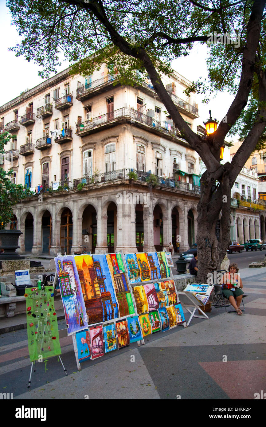 Colourful paintings in front of the buildings they represent, Havana, Cuba - Stock Image