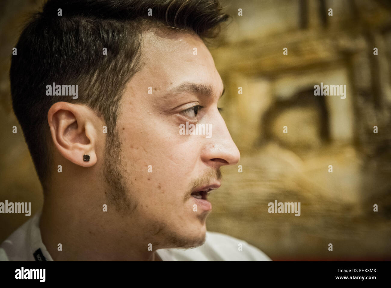 Mesut Özil, German footballer and Arsenal player gives an interview - Stock Image