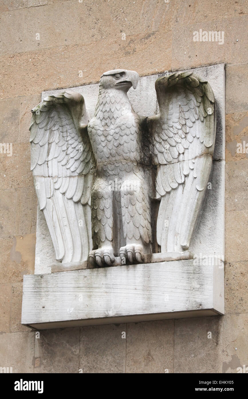Reichsadler. Nazi eagle from the 1930s on the main building of the Tempelhof Airport in Berlin, Germany. - Stock Image