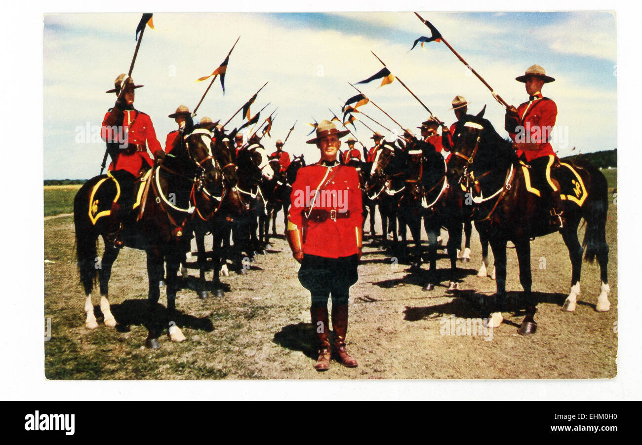The Royal Canadian Mounted Police (RCMP), members of which are pictured here in this 1930s postcard, was formed - Stock Image
