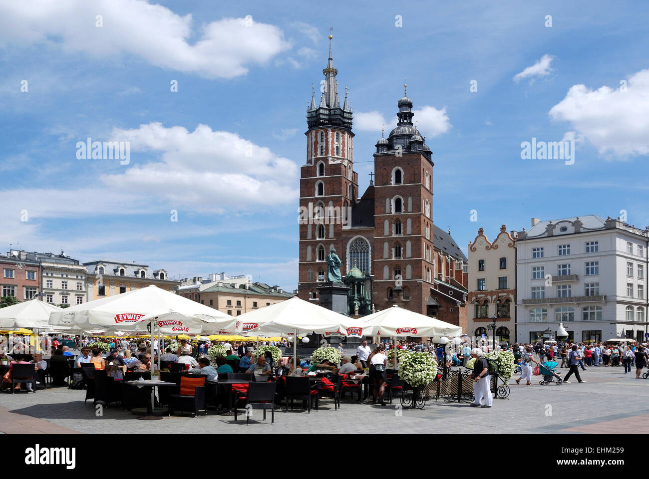 Street Cafe with tourists in front of the St. Mary's Church on the Main market of Krakow in Poland.   Achtung: Nur Stock Photo