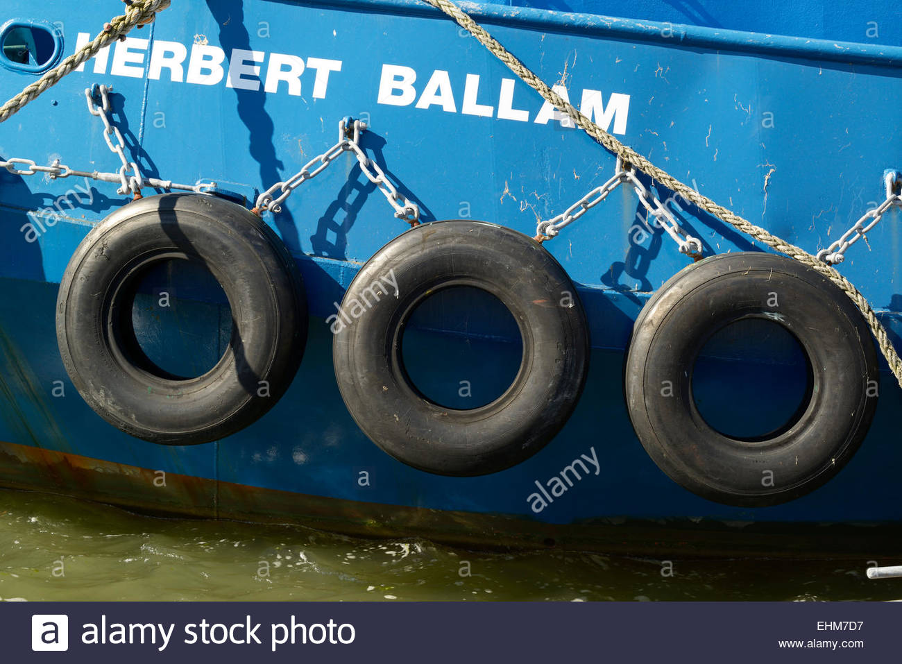 Old car tyres used as boat fenders, Poole harbour, Dorset ...