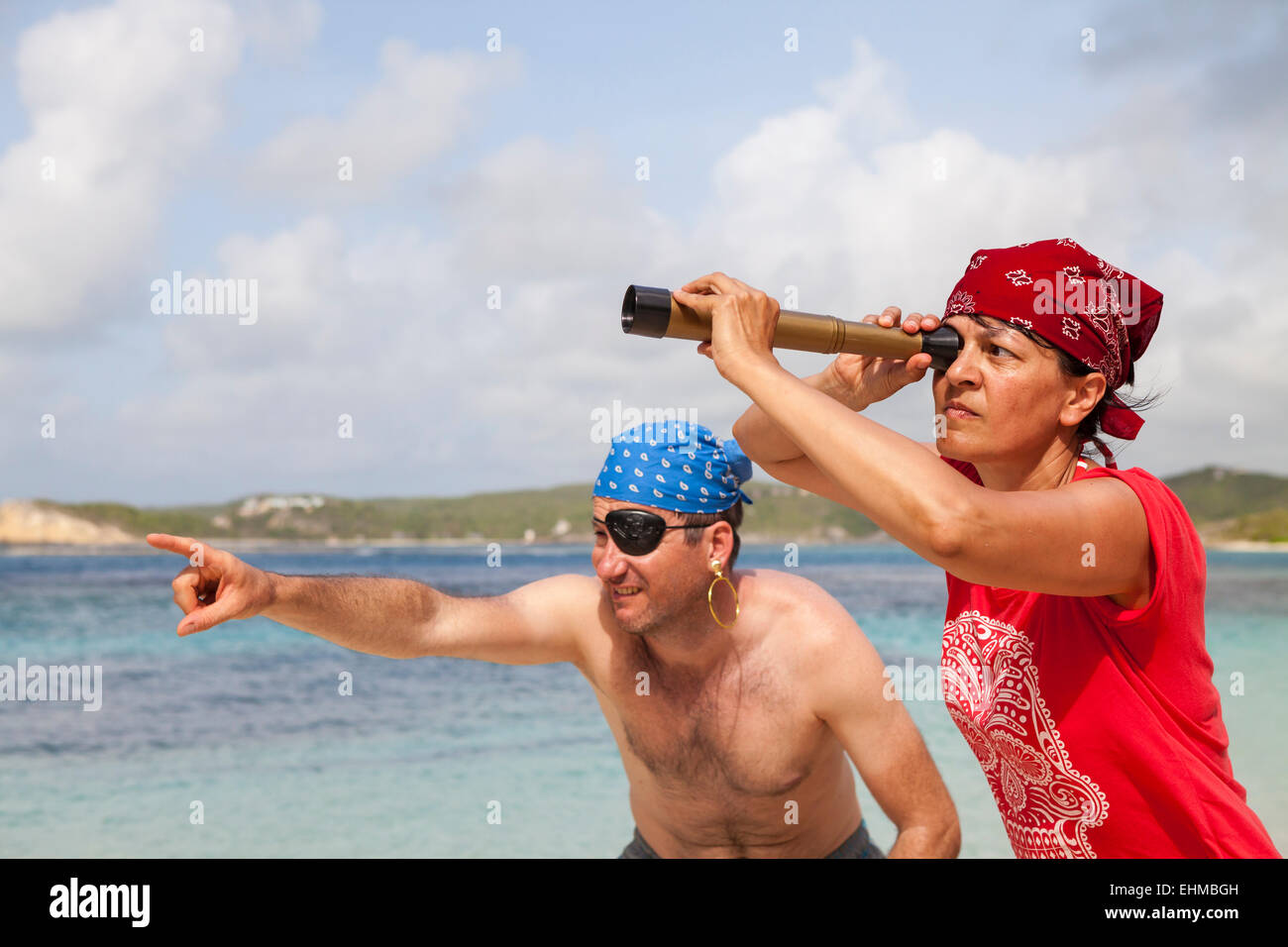 Man and woman dressed up as Pirates of the Caribbean, Nonsuch Bay, Green Island, Antigua, Antigua and Barbuda - Stock Image