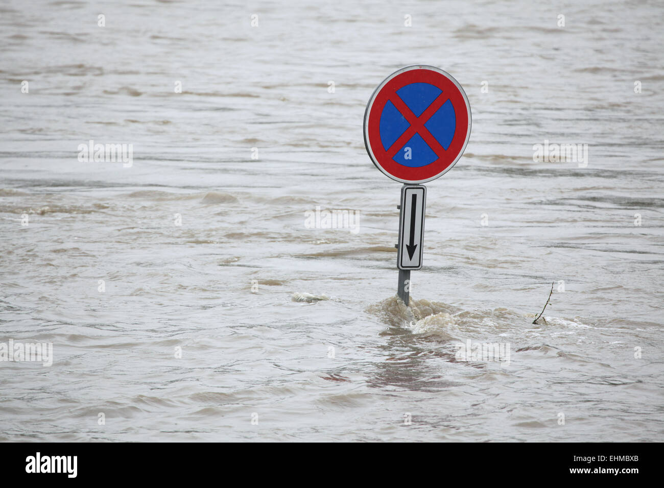No stopping, a traffic sign partially flooded by the swollen Vltava River in Prague, Czech Republic. - Stock Image