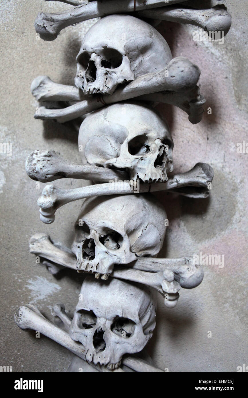 Decoration made of human bones and skulls in the Sedlec Ossuary near Kutna Hora, Czech Republic. - Stock Image