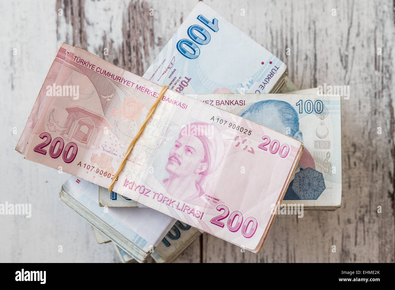Bunch of Turkish Lira over white wooden background Stock Photo
