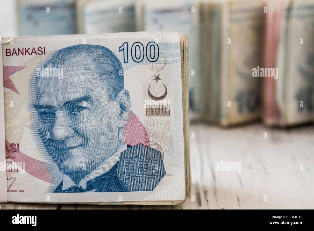 Bunch of Turkish Lira over white wooden background Stock Photo