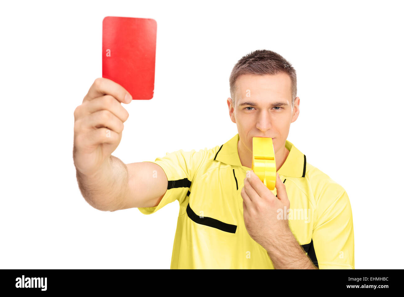 Referee showing red card and blowing huge whistle isolated on white background - Stock Image