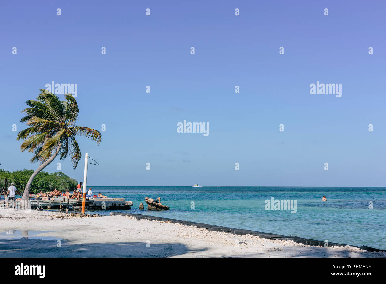 Sunbathers at The Split, Caye Caulker - Stock Image