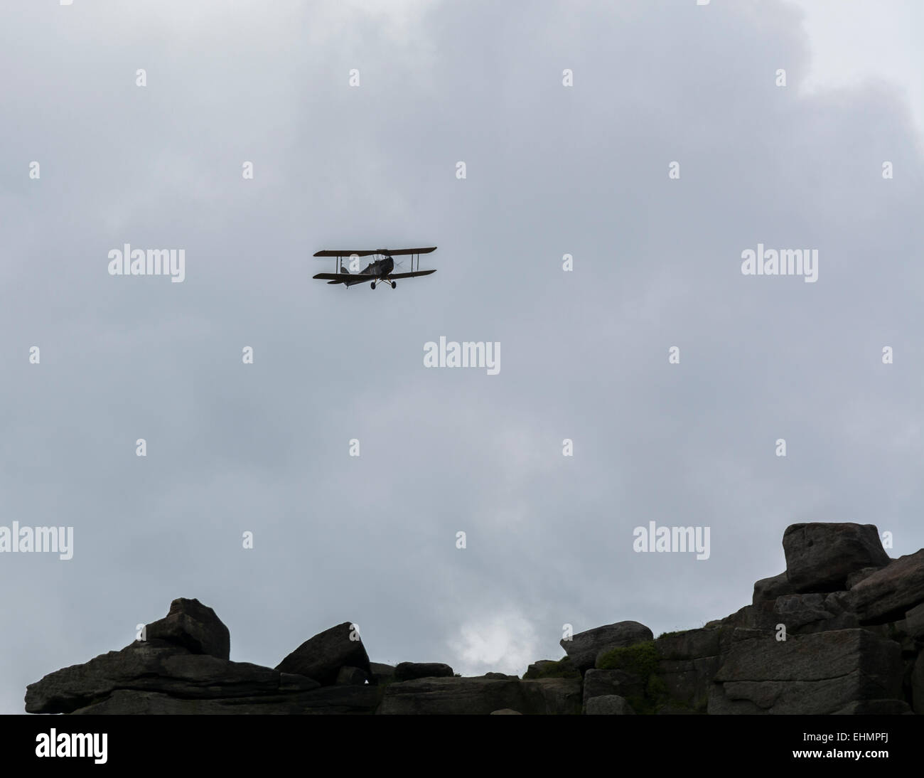 Bi plane in the sky over the Derbyshire Peak District England - Stock Image