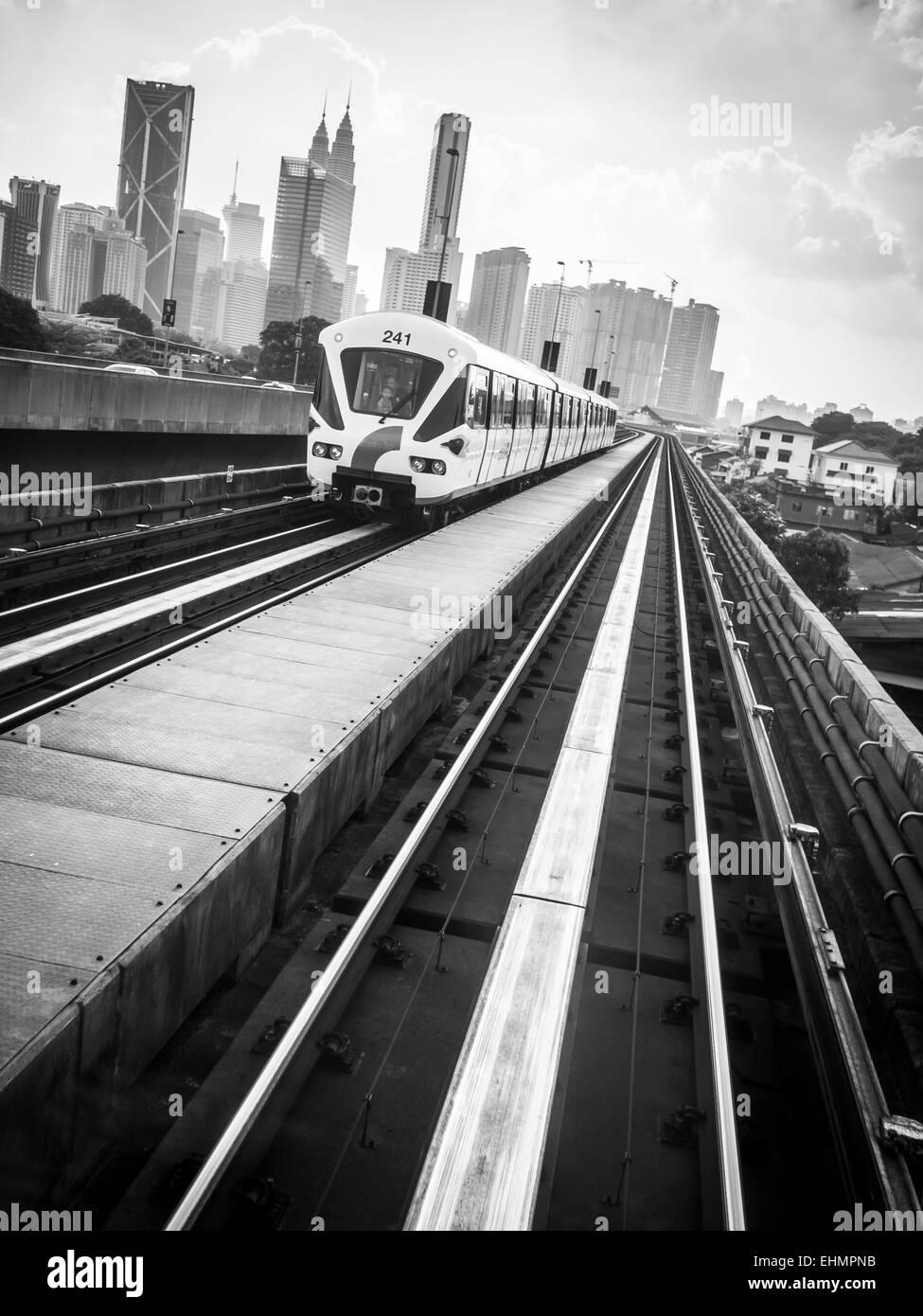 Rail tracks heading towards the city - Stock Image
