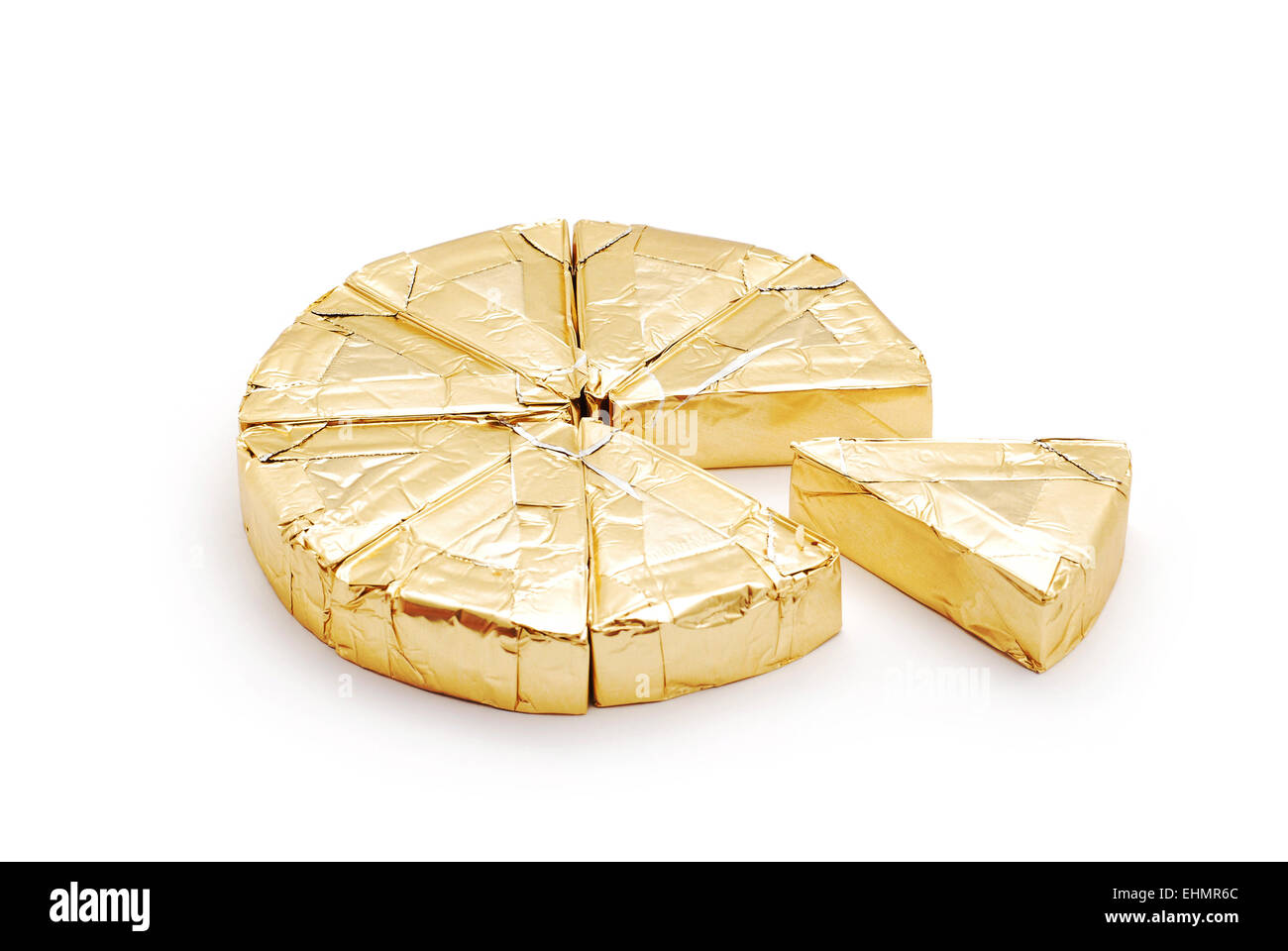 cheese triangles in foil on white - Stock Image