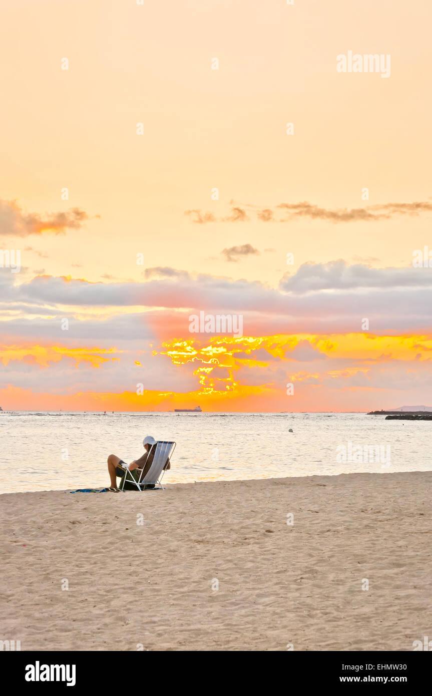 Honolulu, HI, USA - September 6, 2013: unidentified tourist enjoy sunset in Waikiki beach. - Stock Image
