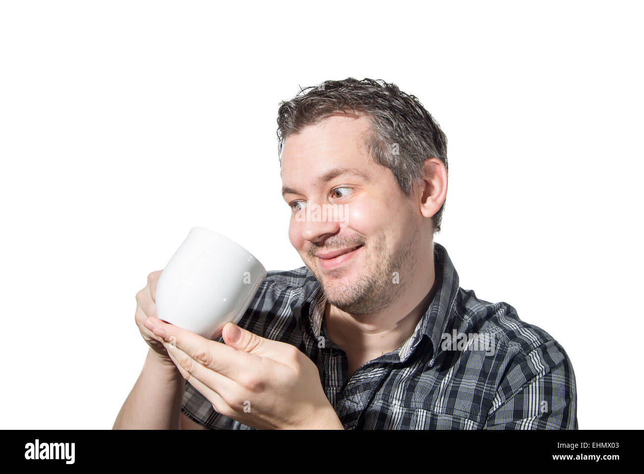 Picture of a man that cares really much about his coffee - Stock Image