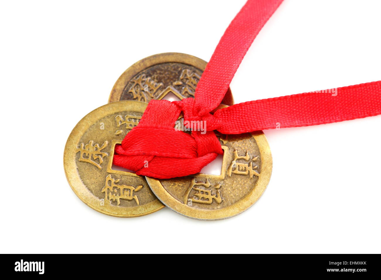 Three Chinese coins tied with red ribbon Stock Photo