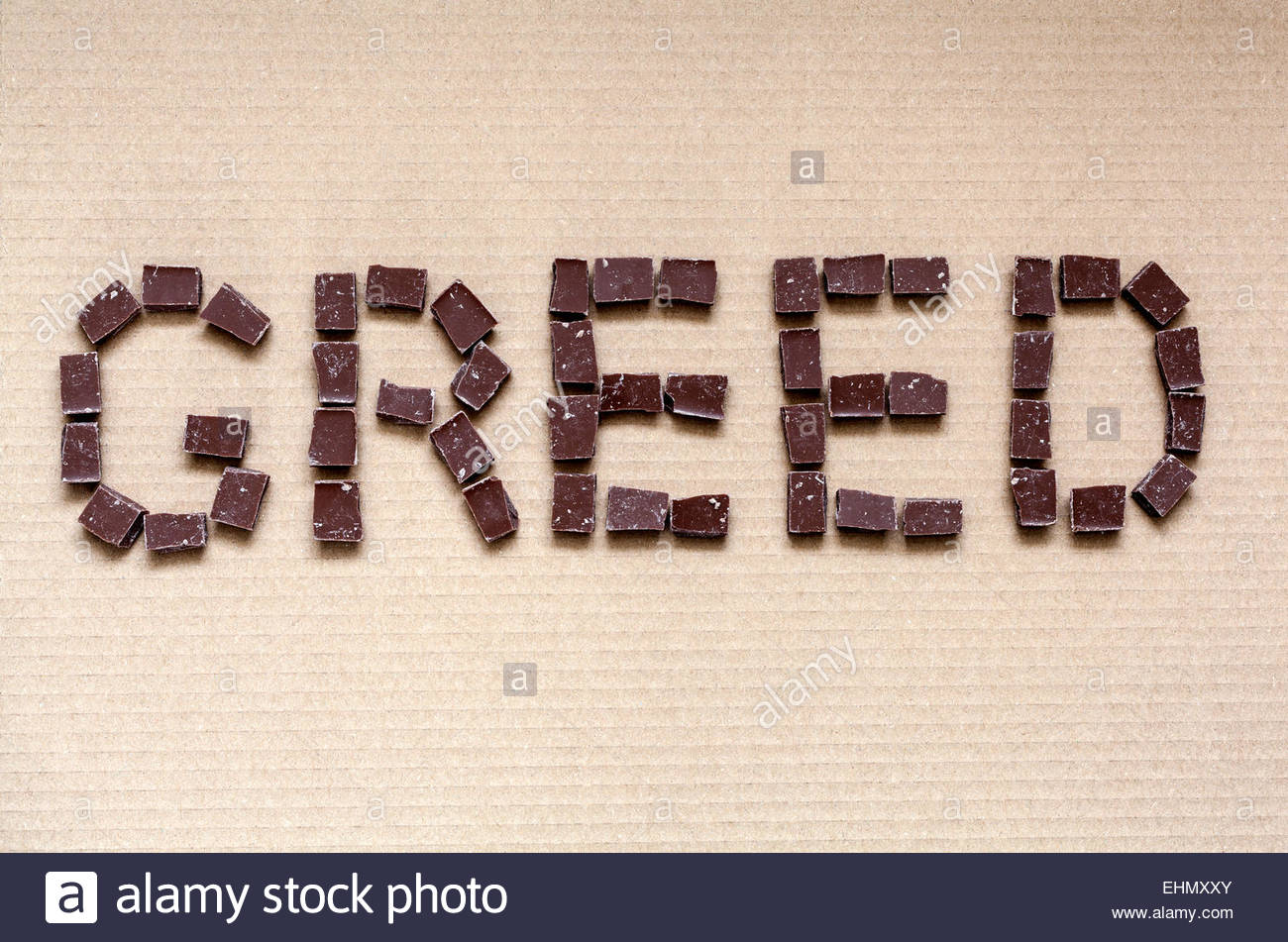The word GREED spelled out using chocolate - Stock Image