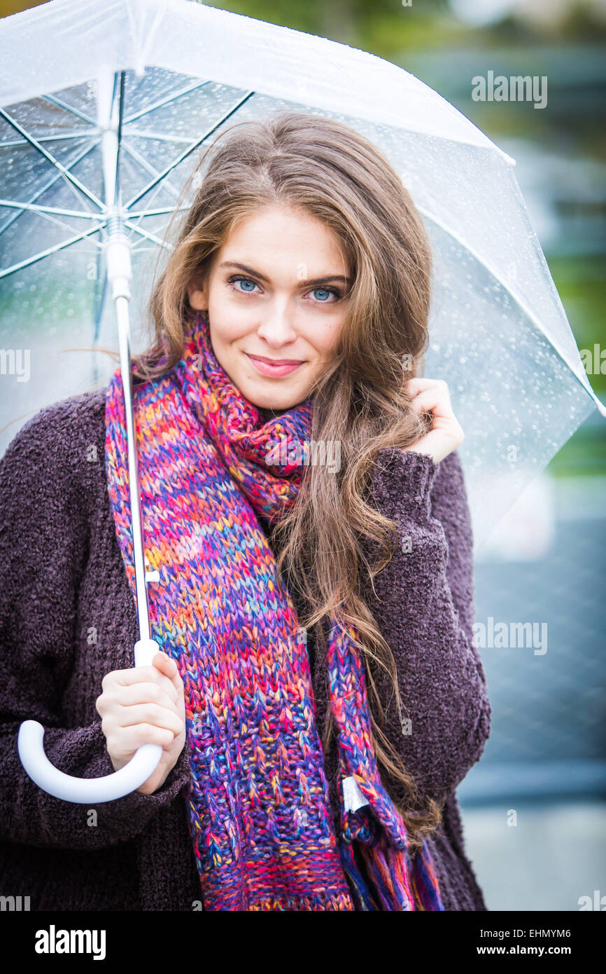 Woman under an umbrella. - Stock Image