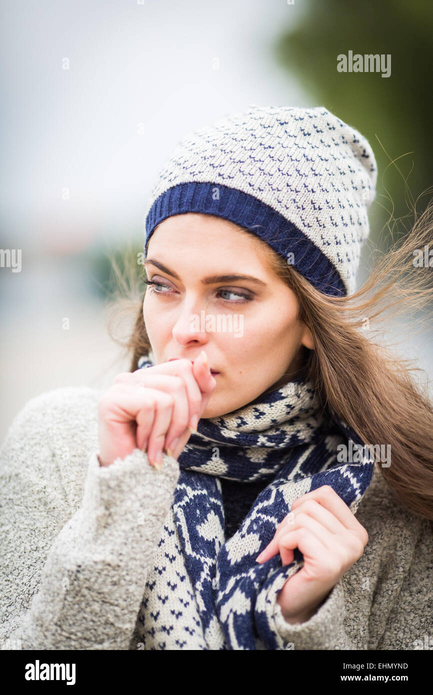 Woman coughing. - Stock Image