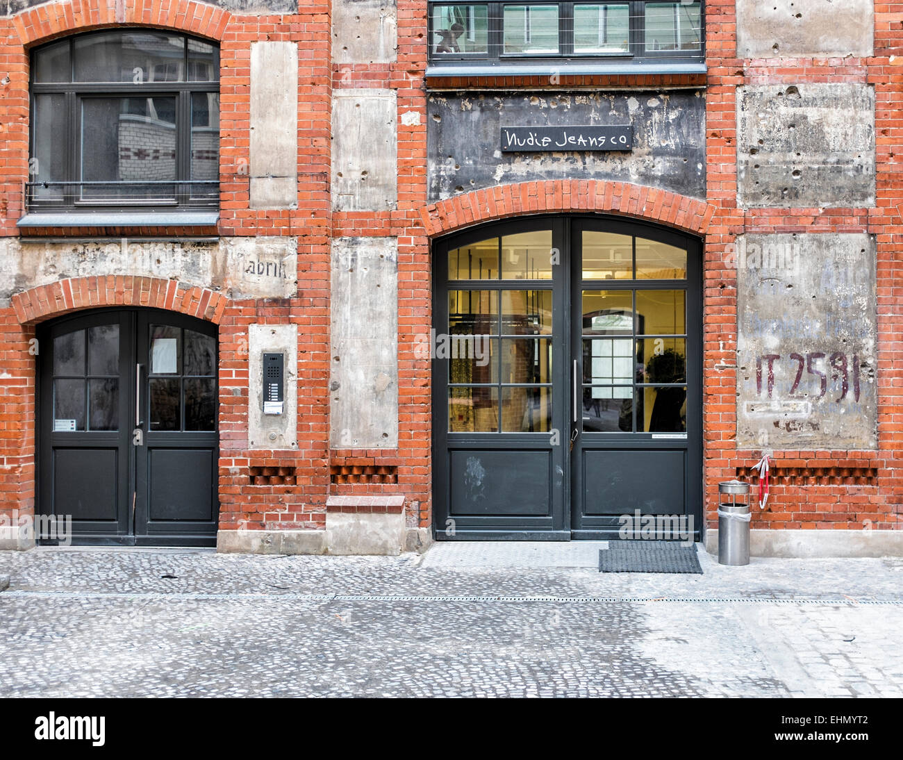 Nudie Jeans shop in inner courtyard of newly renovated old historic building, Mitte, Berlin - Stock Image