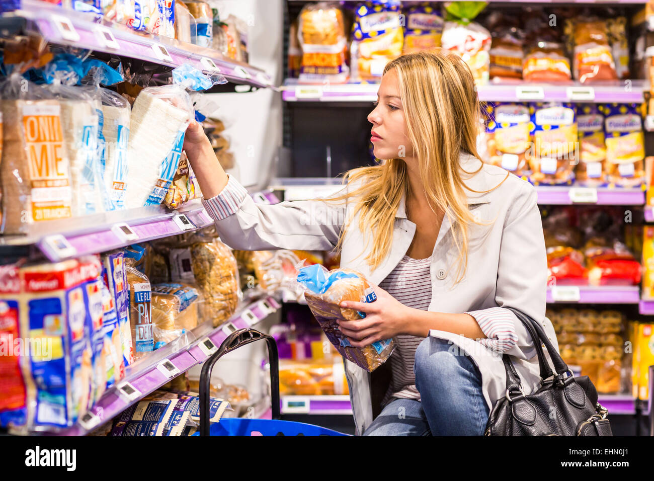 Woman in a supermarket. - Stock Image