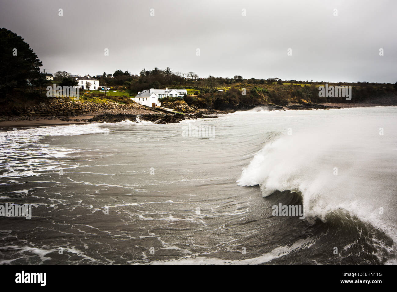 Stormy waves batter homes on the west coast of Ireland - Stock Image