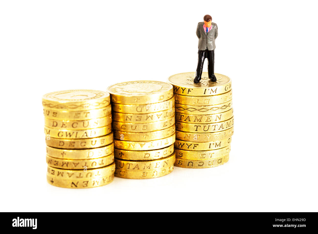 debt debts money worries trouble bankruptcy bankrupt isolated cut out cutout white background pound coins stacks - Stock Image