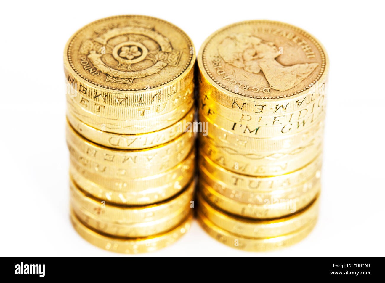 pound coins stacks close detail money cash UK currency isolated cut out cutout white background - Stock Image