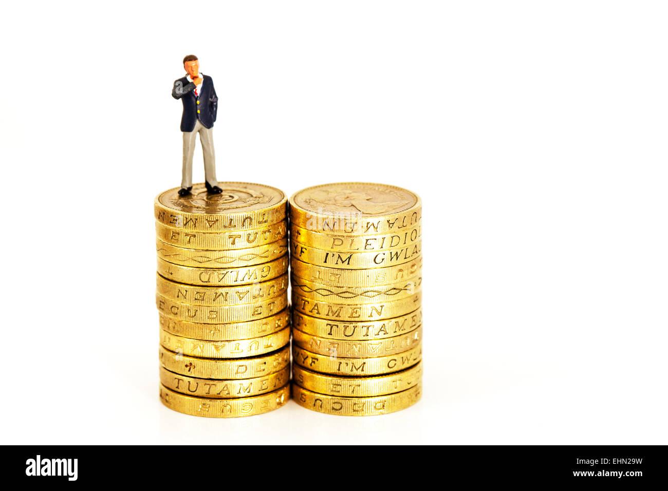 finance financial finances fat cats coins earnings executive executives man management mini miniature money pay - Stock Image