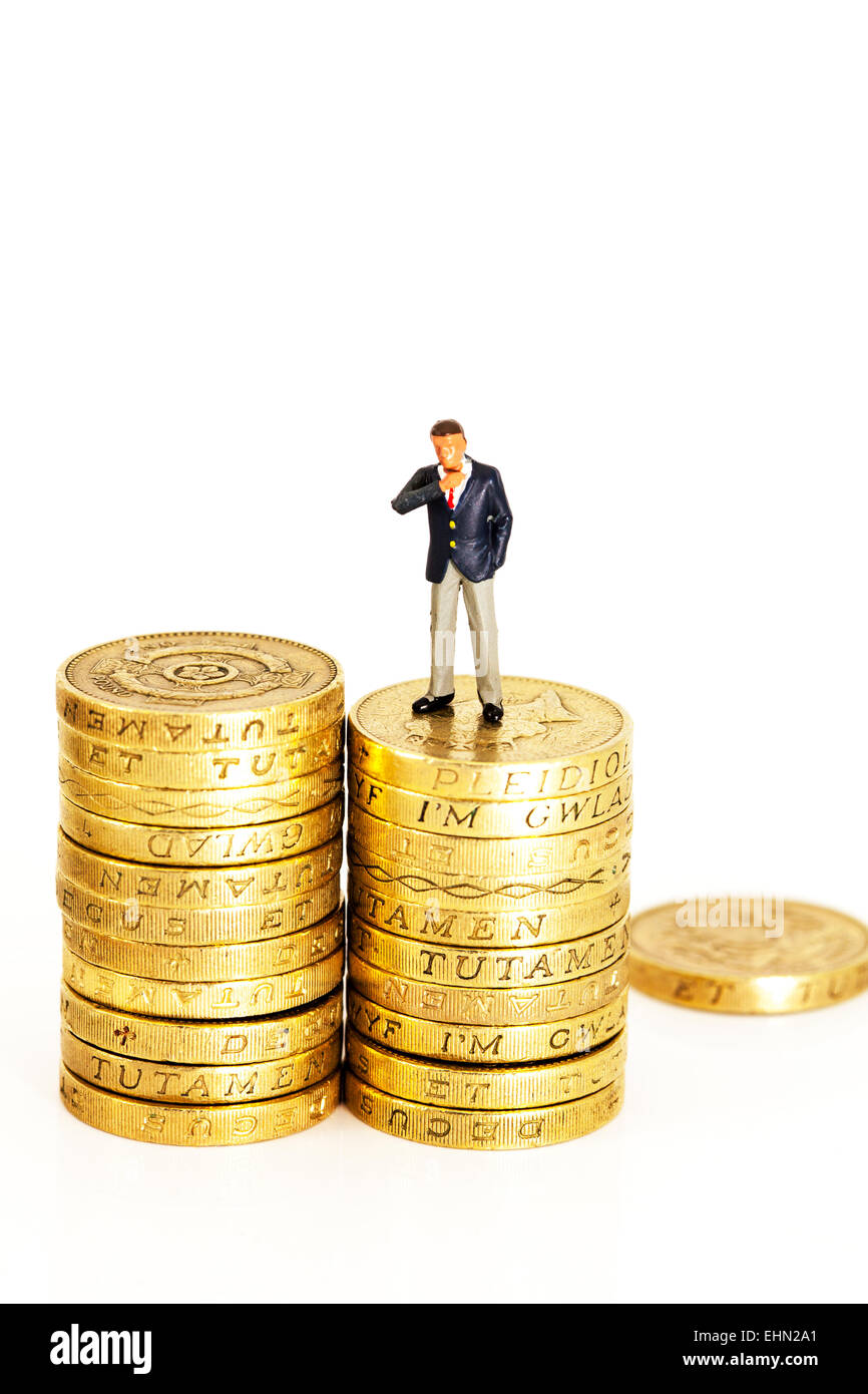 finance financial finances fat cats coins earnings executive executives man management mini miniature money pay - Stock Image