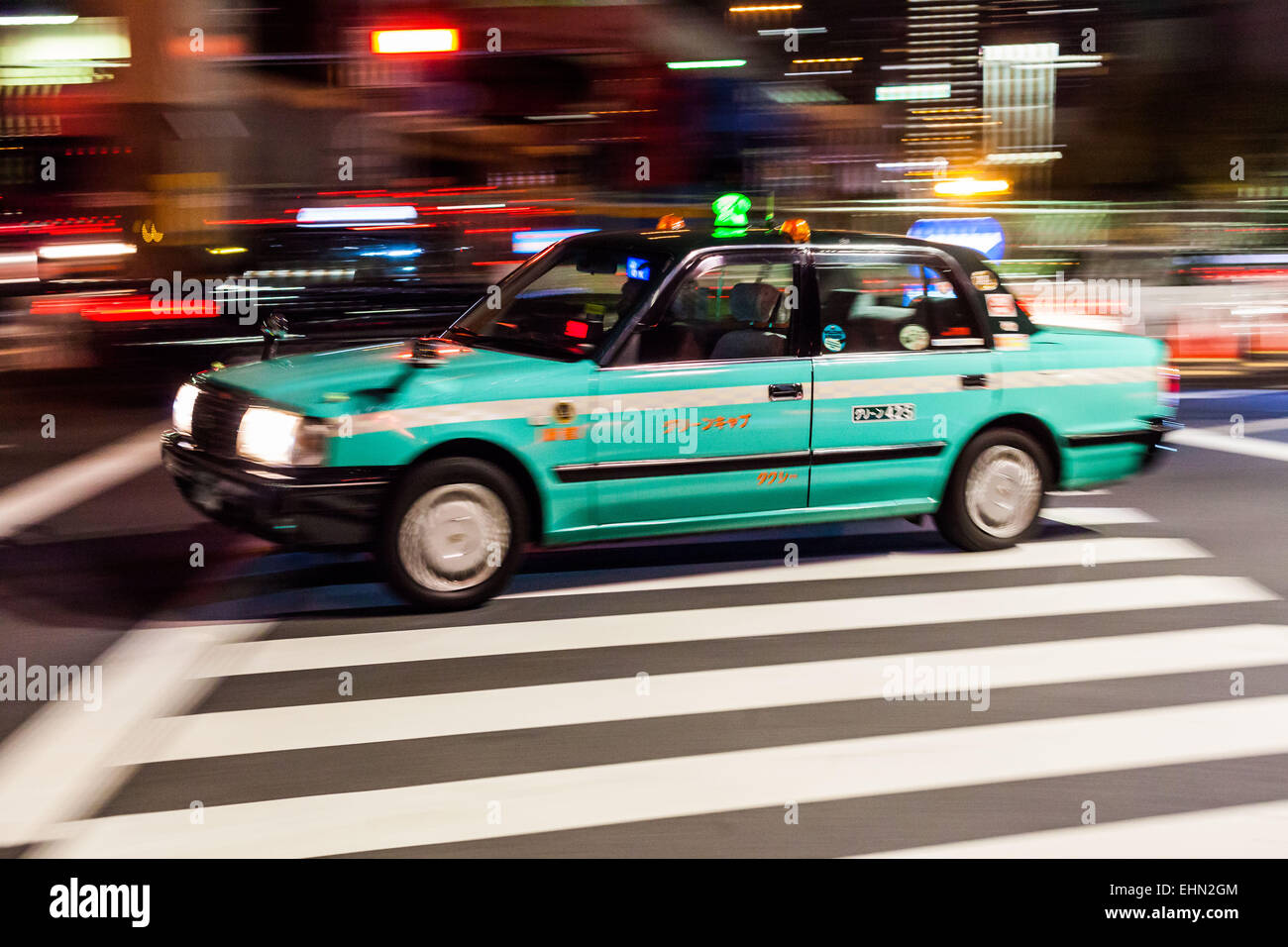 Taxicab in the streets of Tokyo, Japan. - Stock Image