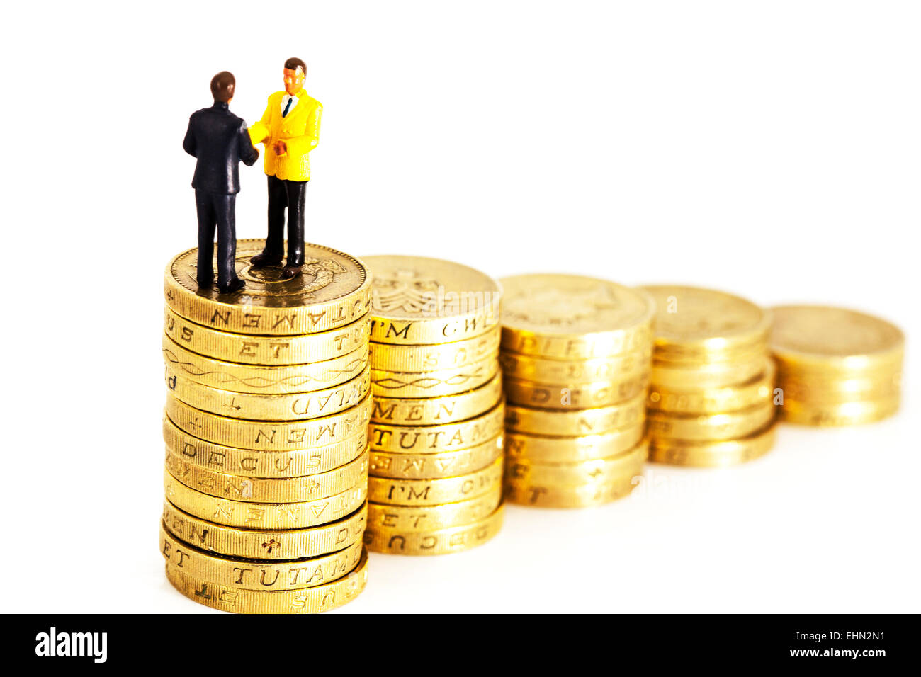 finance financial finances business businessman businessmen cash fat cats pound pounds coins deal hand shake handshake - Stock Image