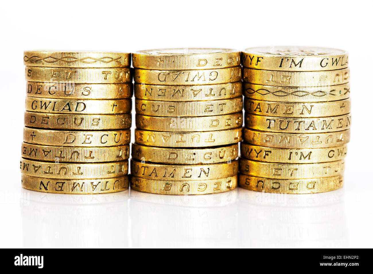 pound coins stacks close detail money cash UK currency isolated cut out cutout white background rich richer richest - Stock Image