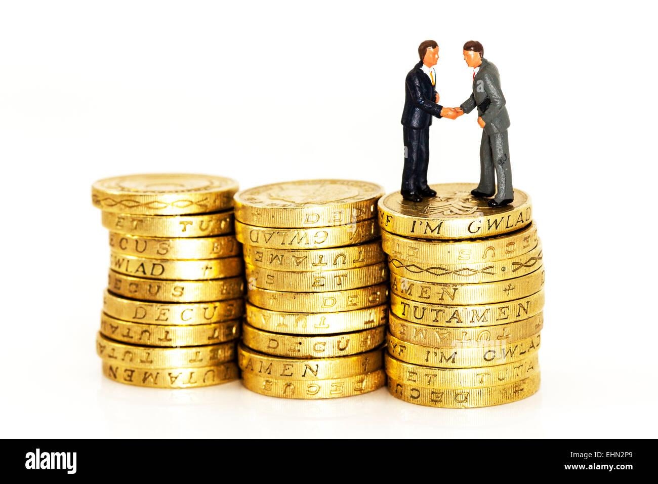 business businessman businessmen cash fat cats coins earnings executive executives finance financial man management - Stock Image