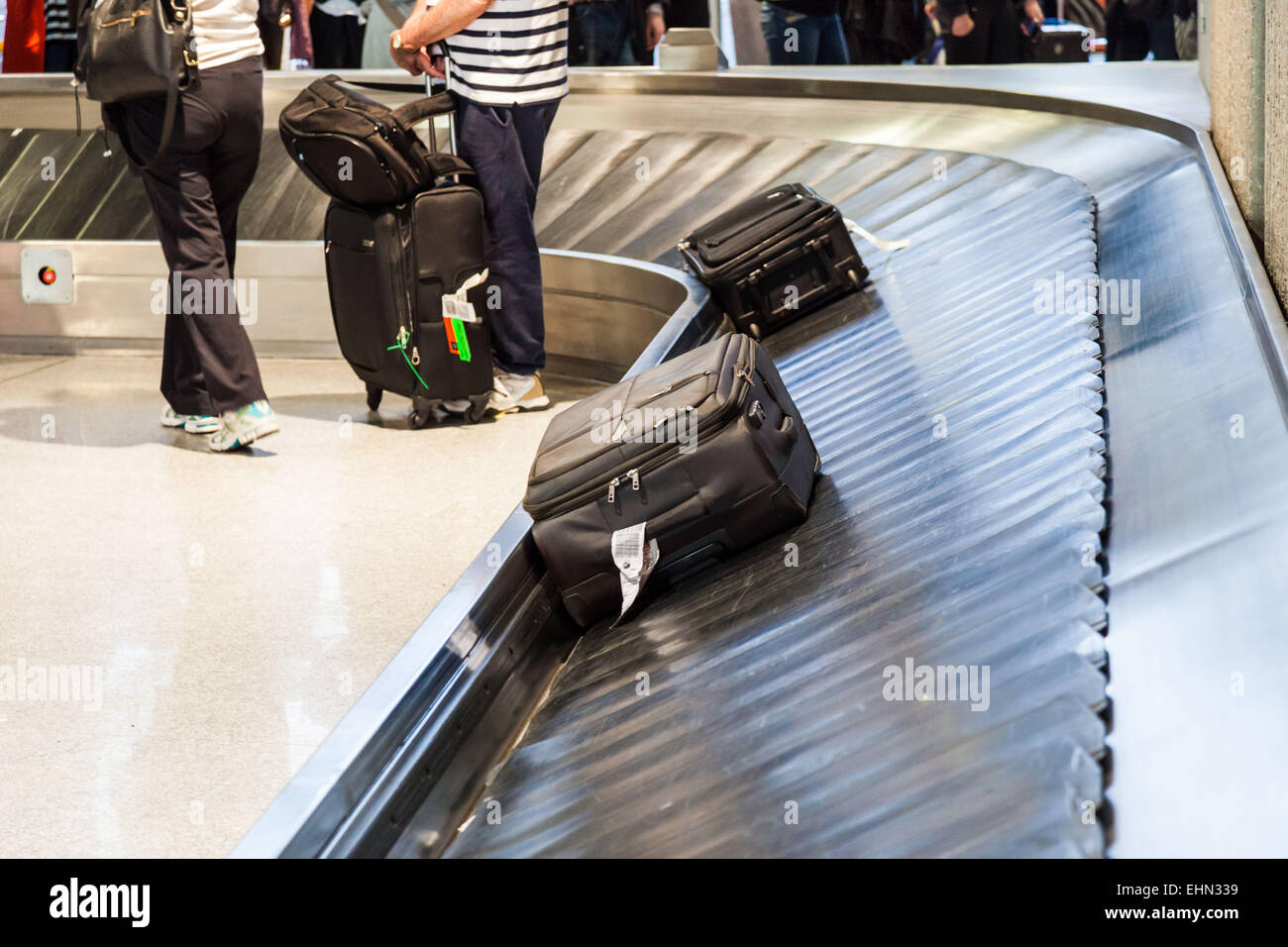 Luggage at an airport. - Stock Image