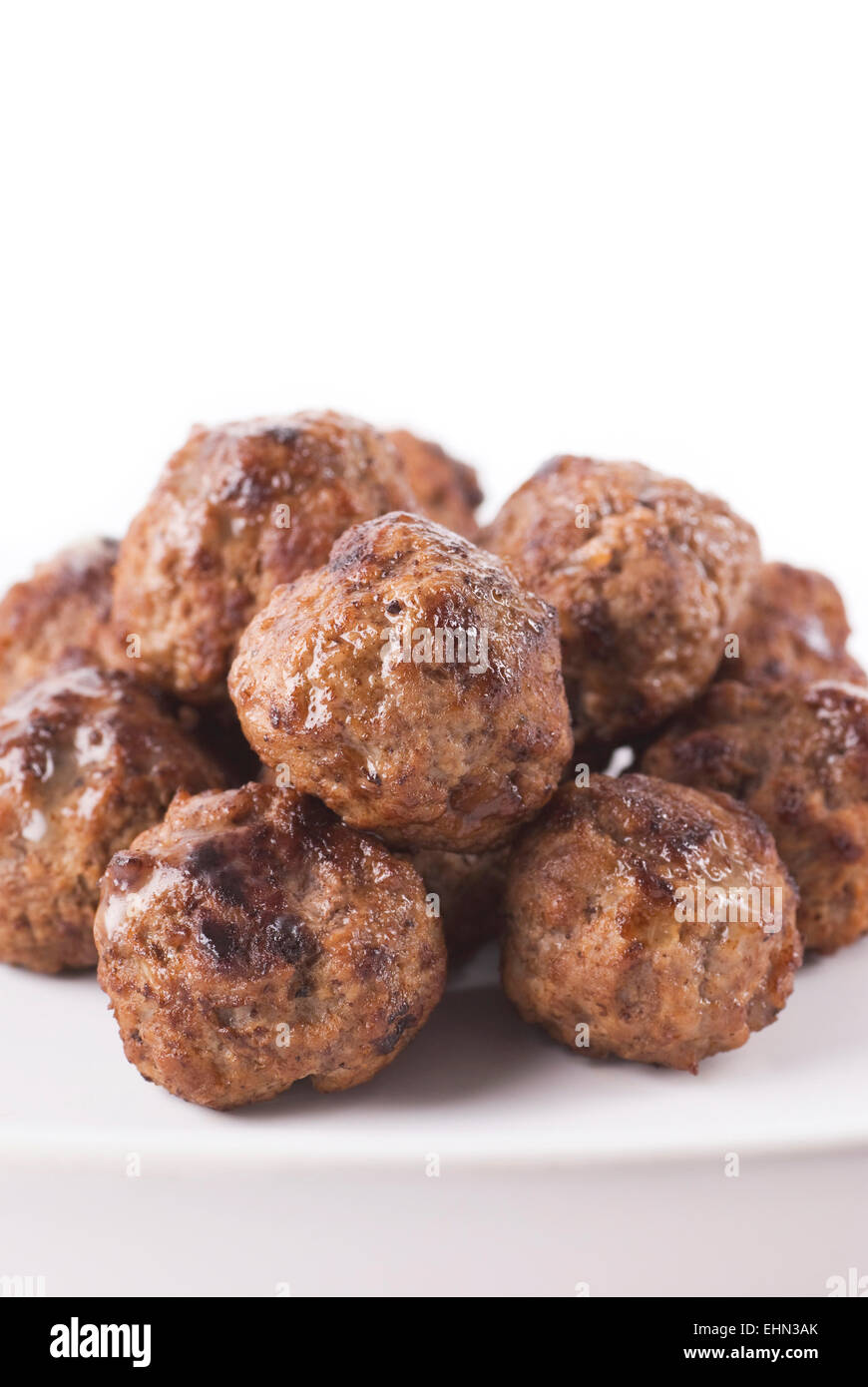 Meat balls on a plate. White background close up. - Stock Image