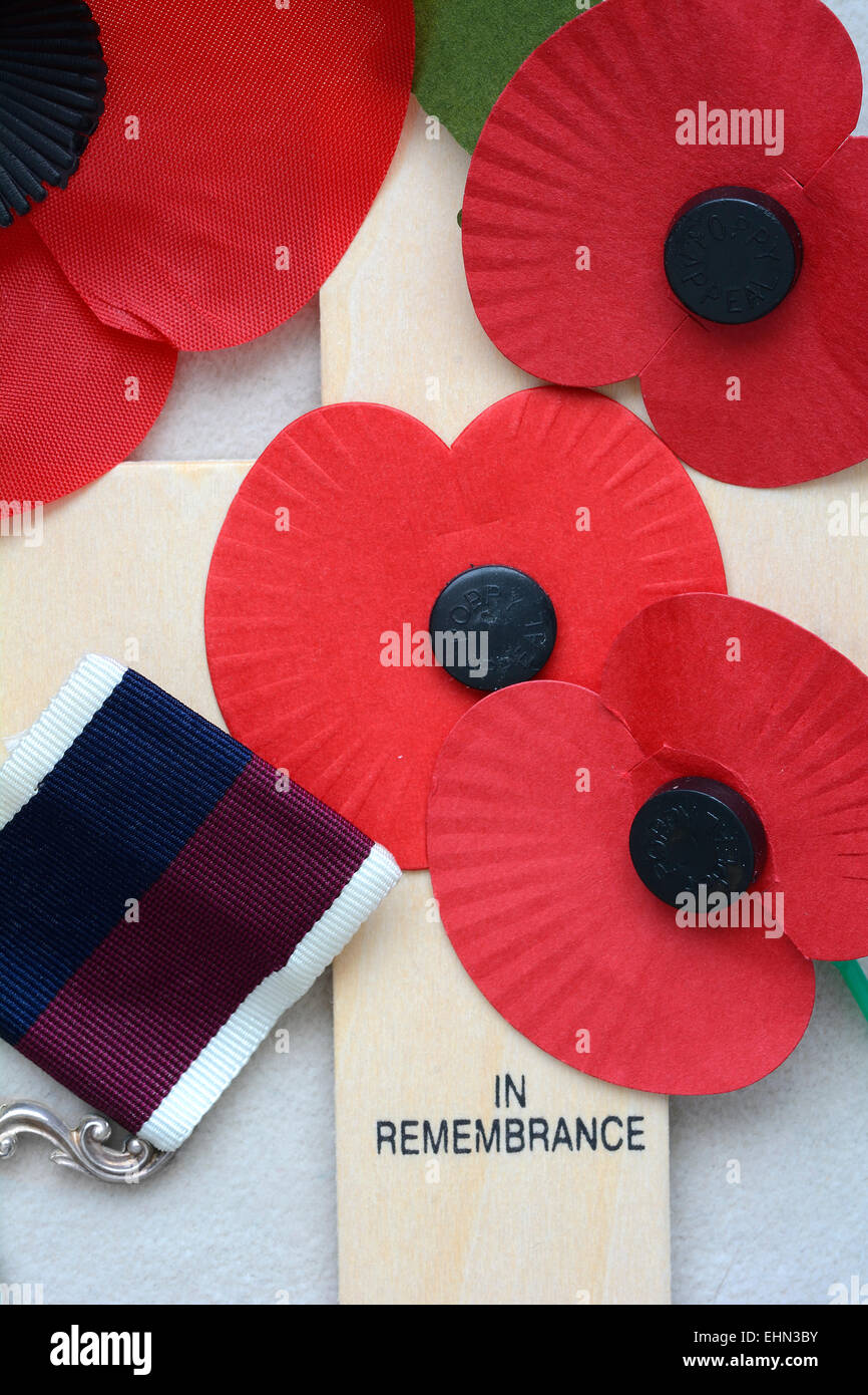 Military remembrance cross with poppies and medal stock photo military remembrance cross with poppies and medal mightylinksfo